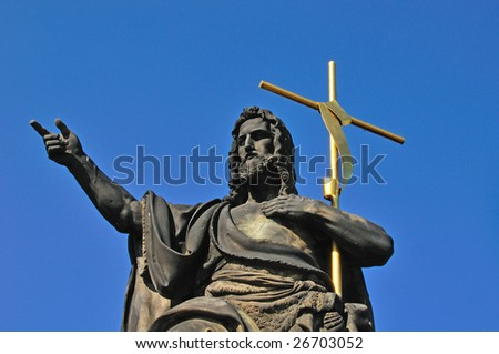 Statue of Christ on Karl's bridge in Prague, Czech Republic.