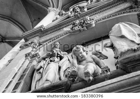 Statue of crying angel in the Cathedral of Notre Dame, Amiens, France