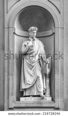 Statue of Dante Alighieri in the niches of the Uffizi Gallery colonnade, Florence. - stock photo