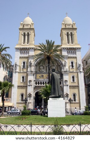Statue of Ibn Khaldoun in front of the Catholic Cathedral of St Vincent de , Tunis, Tunisia - stock photo