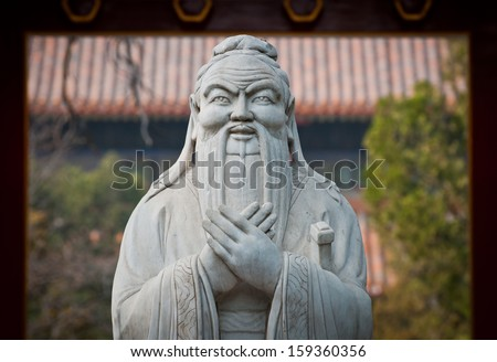 statue of in Confucius in The Temple of Confucius on Guozijian Street in Beijing, China - stock photo