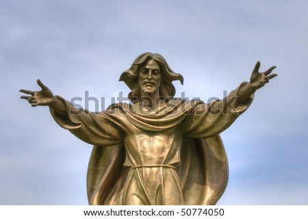 Statue of Jesus with open arms in bronze