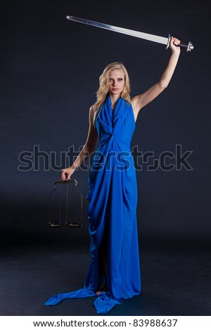 Statue of justice. Blond Woman with scale and sword. - stock photo
