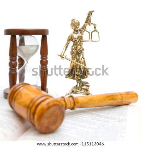statue of justice, gavel, law book and hourglass on a white background close-up - stock photo