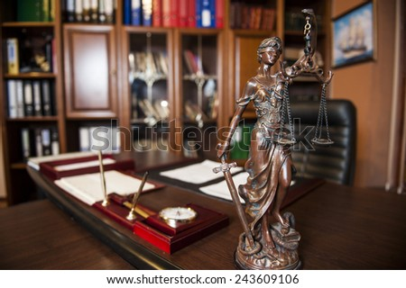 Statue of justice in the judge's chambers. - stock photo
