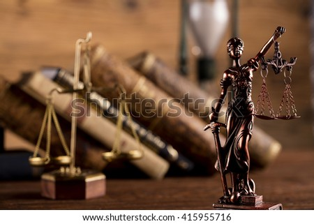 Statue of justice, scales of justice,books, hourglass, law theme - stock photo
