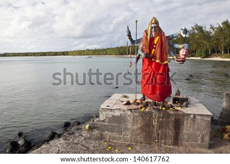 Statue of Kali, Hindu goddess, in outdoor temple on beach of Mont Choisy, Mauritius island