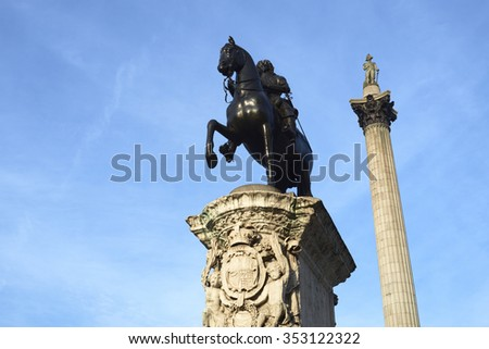 Statue of King Charles I in Trafalgar Square with Nelson's Column in the background. - stock photo