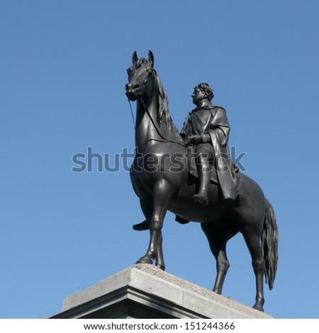 Statue of king George IV in Trafalgar Square in London - stock photo