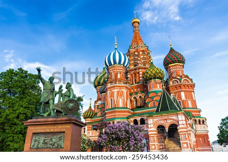 Statue of Kuzma Minin and Dmitry Pozharsky in front of St. Basil Cathedral in Moscow, Russia. The cathedral was built between 1555 and 1561. The Minin and Pojarsky monument was erected in 1818. - stock photo