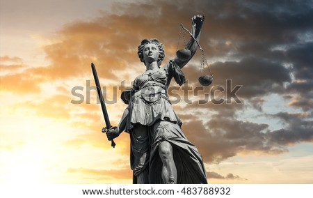 Statue of Lady Justice (Justitia) with sunset sky, Germany