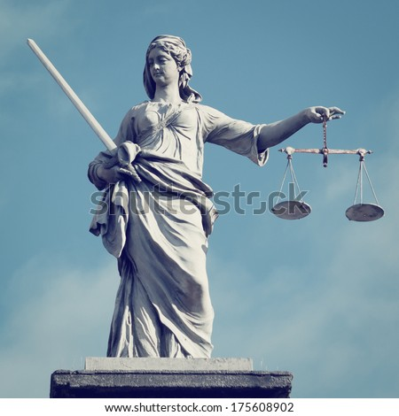 Statue of Lady Justice statue with retro effect. - stock photo