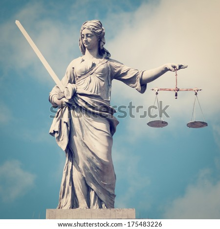 Statue of Lady Justice with retro effect. - stock photo