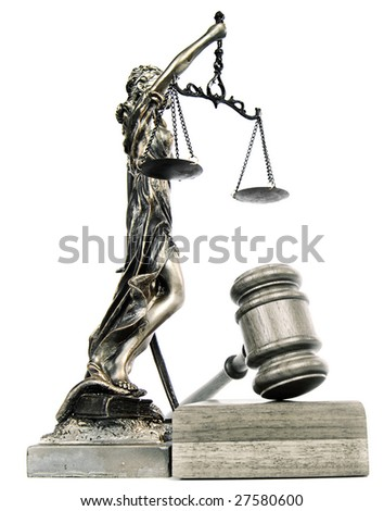 Statue of lady liberty holding a balance scale and a gavel - stock photo