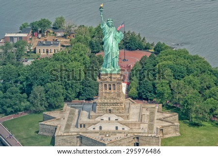 statue of liberty aerial view from helicopter - stock photo