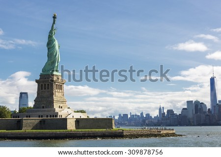 Statue of Liberty and the New York City Skyline, USA. - stock photo
