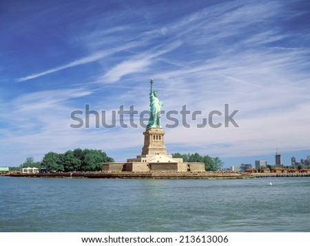 Statue of Liberty at sunny day. - stock photo