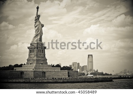 Statue of liberty before skyline of New Jersey - stock photo