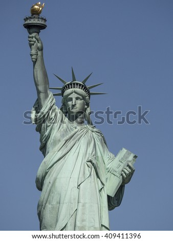 Statue of Liberty close up in the early morning with blue sky - stock photo