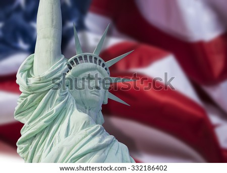 Statue of Liberty close up with shadow on American flag in New York City - stock photo