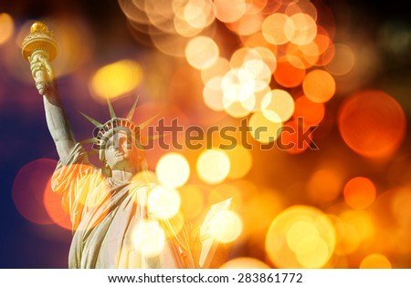 Statue of liberty, double exposure with defocused lights - stock photo