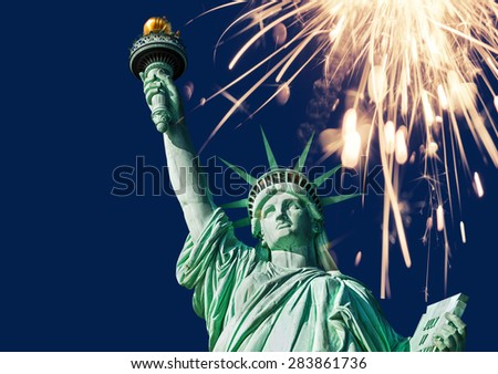Statue of liberty, double exposure with sparkler - stock photo