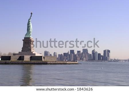 Statue of Liberty, Ellis Island, New York Harbor - stock photo