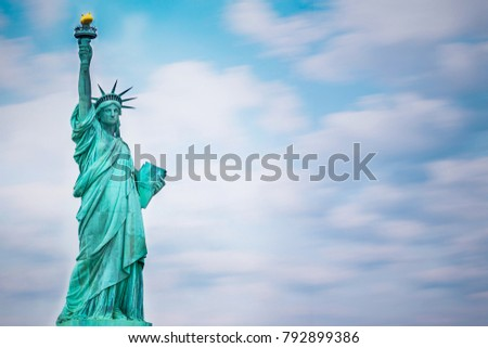 Statue of Liberty in front of blue sky in New York City, USA