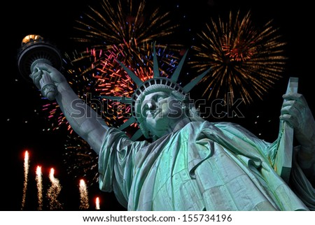 Statue of Liberty in New York and fireworks in the background  - stock photo