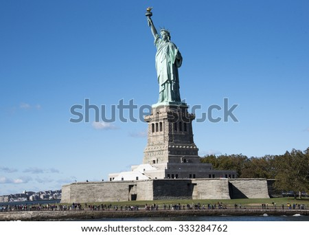 Statue of Liberty in New York City a major tourist landmark in the Big Apple. The Statue of Liberty or Liberty Enlightening the World is a colossal neoclassical sculpture on Liberty Island.  - stock photo