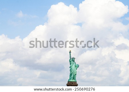 Statue of Liberty in New York with dark cloudsCity Manhattan Hudson River - stock photo
