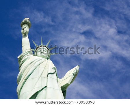 Statue of Liberty isolated on blue sky background