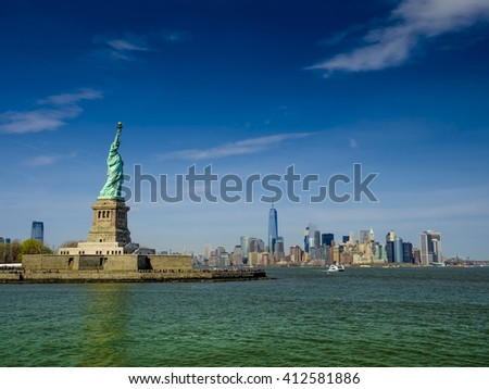 Statue of Liberty on a sunny day, real view - stock photo