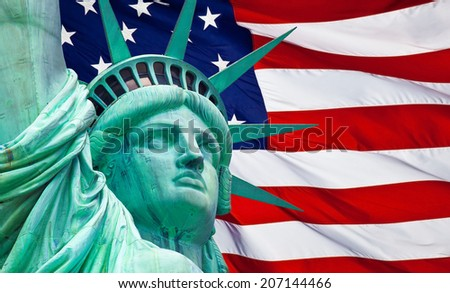 Statue of Liberty on Island in New York with flag of the United States of America  - stock photo