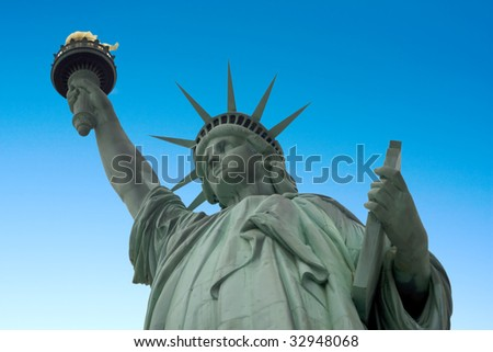 Statue of liberty with a blue sky background - stock photo