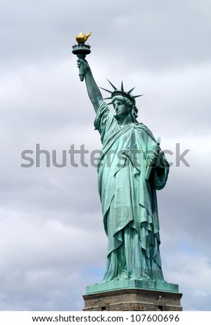 Statue of Liberty with cloudy sky - stock photo
