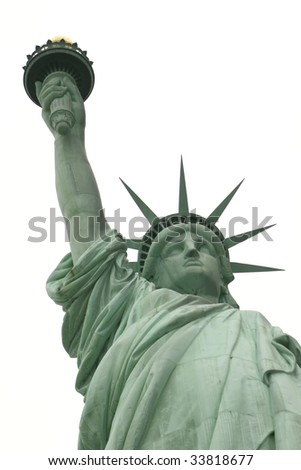 Statue of Liberty with torch on a white sky background - stock photo