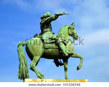 Statue of Louis XIV in front of the Versailles palace near Paris - stock photo