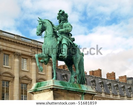 Statue of Louis XIV in front of versailles palace near Paris - stock photo