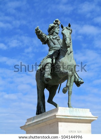 Statue of Louis XIV, Versailles, France - stock photo