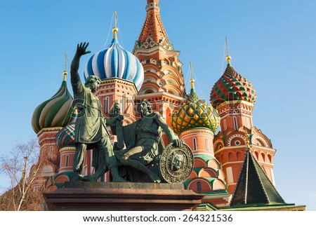 Statue of Minin and Pozharsky on the Red Square in Moscow Russia. Saint Basil's Cathedral on the background. - stock photo