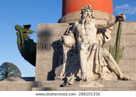 Statue of Neptune with an oar and female figure on the bow in the rostral column in St. Petersburg - stock photo