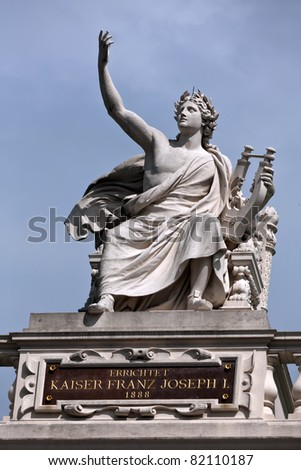 Statue of Orpheus holding a lyre in an ancient Greek style on top of a building in Vienna. - stock photo