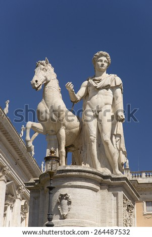 Statue of Pollux in front of the Senatorio Palace in the Piazza del Campidoglio at the top of Capitoline Hill in Rome, Italy, Europe  - stock photo