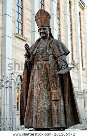 Statue of Pope John XXIII in front the Cathedral of St Joseph - stock photo