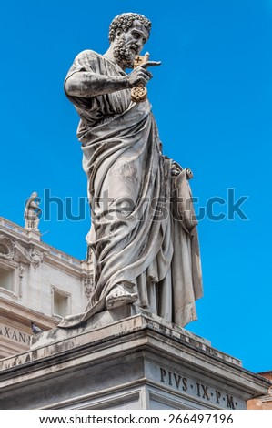 Statue of Saint Peter and Saint Peter's Basilica at background in St. Peter's Square, Vatican City, Rome, Italy - stock photo