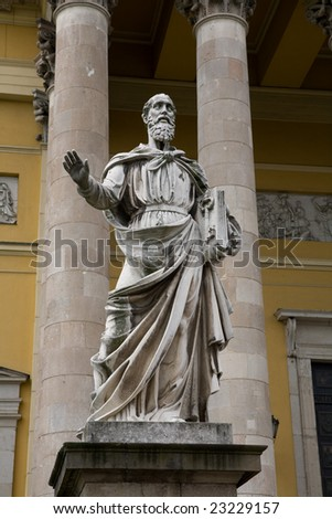 Statue of St. Peter in front of the Basilica in the small town of Eger, Hungary with columns of the church in the background. - stock photo