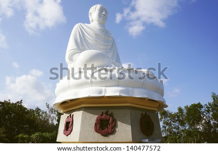 Statue of the Buddha against the blue sky. Temple of the Buddha. Vietnam, Nha Trang, Pagoda. - stock photo