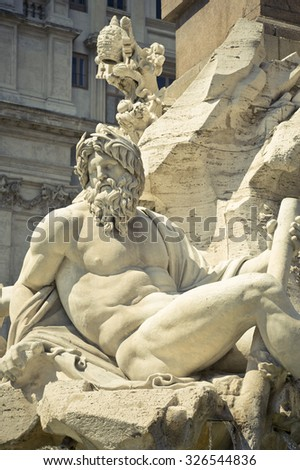 Statue of the god Zeus in Bernini's Fountain of the Four Rivers in the Piazza Navona, Rome,Italy - stock photo