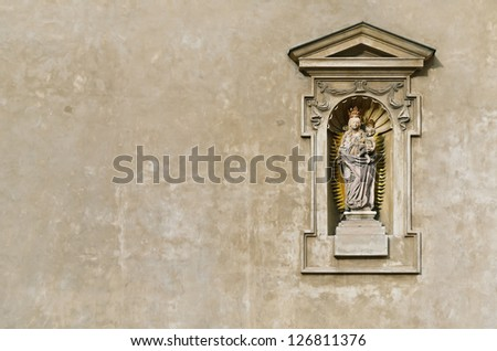 Statue Of The Virgin Mary And Christ Child Installed In The Church Wall, Prague. Czech Republic